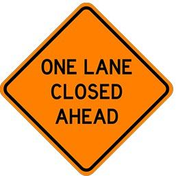 Orange road sign stating &#34One Lane Closed Ahead&#34