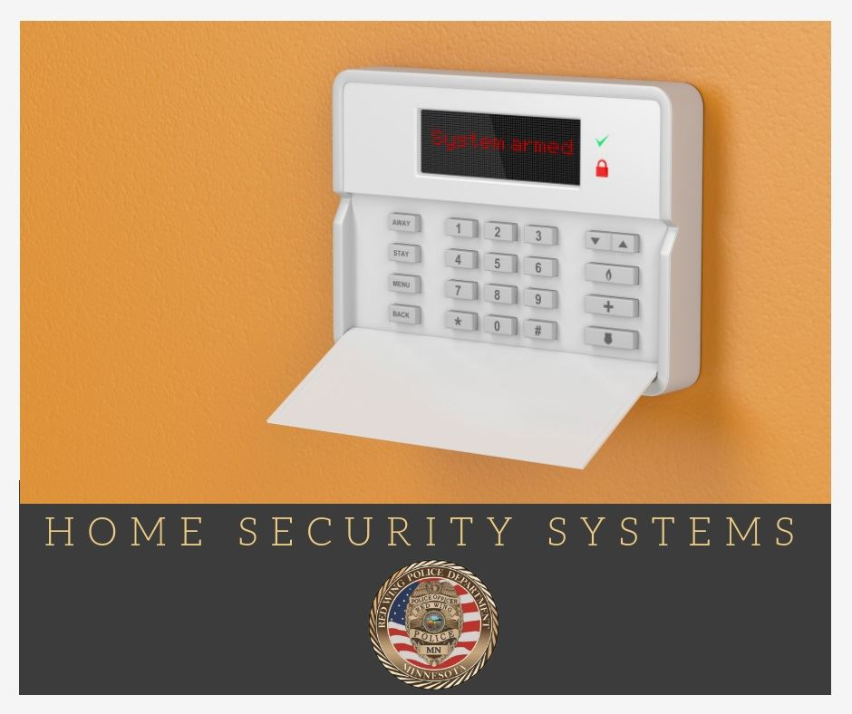 Image of a home security system against an orange wall.