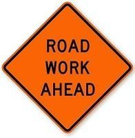 "Image of orange construction sign stating ""Road Work Ahead"""