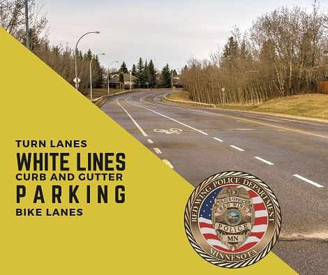 "Image of a road with the words, ""Turn Lanes; White Lines; Curb and Gutter; Parking: Bike Lanes"