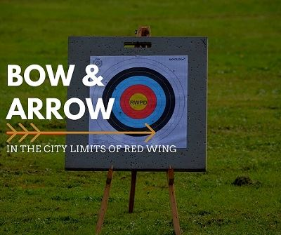 "Photo of an archery target with the words ""Bow & Arrow; in the City Limits of Red Wing"""