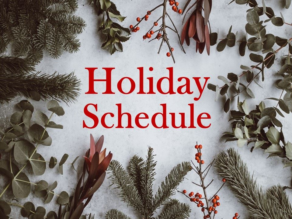 Image of tree branches and berries with the words &#34Holiday Schedule&#34 written over it.