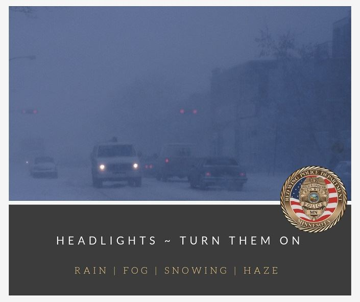 Image of vehicles with headlights on driving through inclement weather.