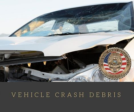 """Image of a damaged white vehicle with the words """"Vehicle Crash Debris"""" and the RWPD seal"""