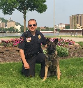 Photo of Officer Dahl and K-9 Archie at their graduation.